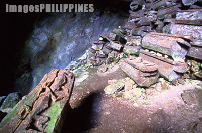 Ancient coffins inside the Lumiang Coffin Cave in Sagada.,  Place Taken: Mountain Province take on  Date Taken: 2002