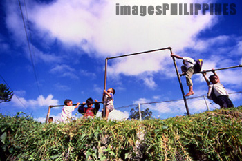 Sagada children playing at a playground near their 