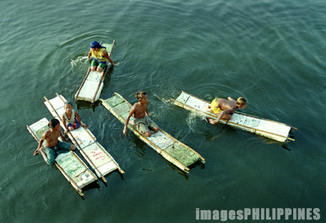 """Five Young Coin Divers in Manila Pier""