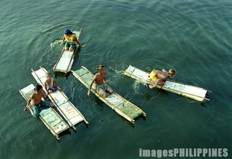 """""""Five Young Coin Divers in Manila Pier"""",  Place Taken: Metro Manila take on  Date Taken: 2002"""