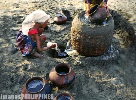 """""""An Old Woman Gathering Salt Water in the Beach"""",  Place Taken: Suba Beach, Laoag, Ilocos Norte take on  Date Taken:  1991"""