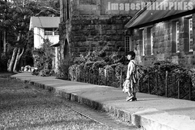 Little girl walking home from school near St. Mary's 