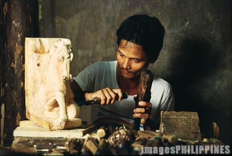 """""""Wood Carver"""",  Place Taken: Paete, Laguna take on  Date Taken: 1992"""