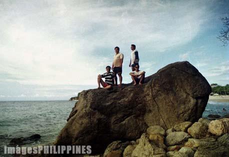 """""""Four men atop a big rock"""",  Place Taken: Puerto Galera, Mindoro Oriental take on  Date Taken: 1993"""