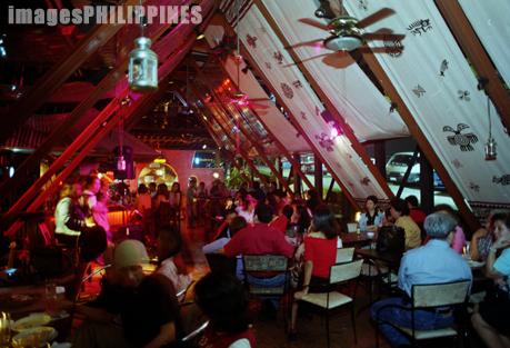 """""""Crowd in a cafe"""",  Place Taken: Makati, Metro Manila take on  Date Taken: 2003"""