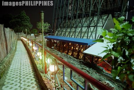 """Cafe by the billboard scaffolding"",  Place Taken: Makati, Metro Manila take on  Date Taken: 2002"