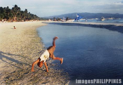 """""""Cart wheeling at the beach"""",  Place Taken: Boracay, Aklan take on  Date Taken: 2002"""