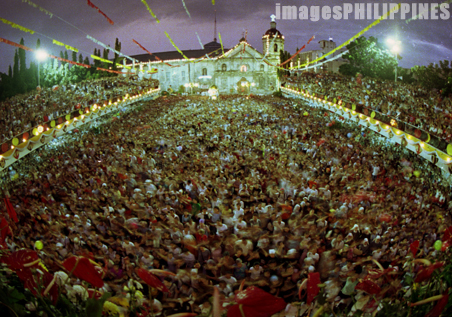 """""""Basilica de Sto Nino crowd praying"""",  Place Taken: Cebu take on  Date Taken: 2002"""