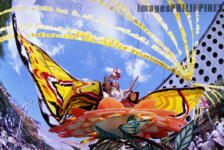 """Sto Nino held on top of a float""