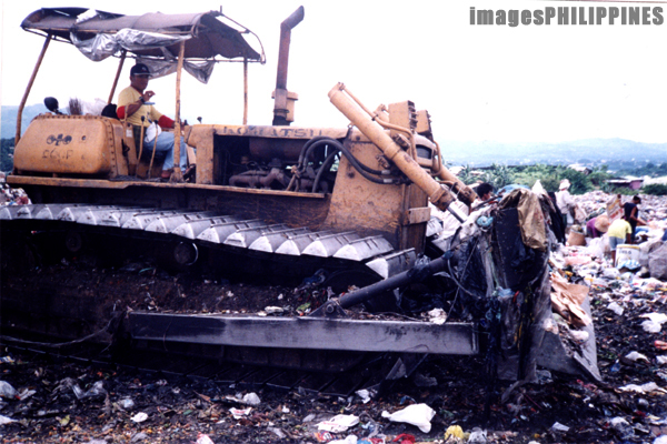 """Bulldozer in the Payatas Landfill""