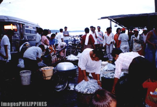 """""""Fish traders"""",  Place Taken: Balayan Bay, Batangas take on  Date Taken: 2003"""