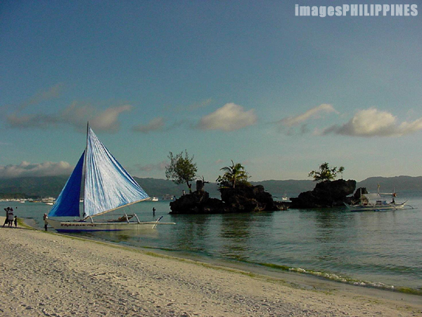 """Sailboat by the Rocks""