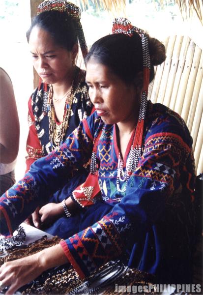 """T'boli women selling bracelets"",  Place Taken: South Cotabato take on  Date Taken: 2002"