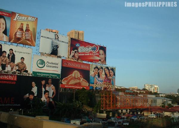 """""""Billboards along the Pasig River"""",  Place Taken: Metro Manila take on  Date Taken: 2003"""
