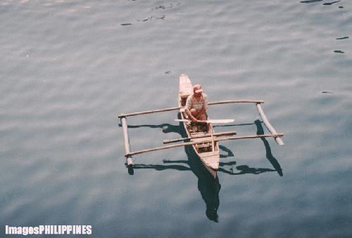 """A Boatman in Cagayan de Oro Wharf"",  Place Taken: Cagayan de Oro take on  Date Taken: 2004"