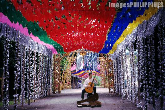 """Guitarist in Villa Escudero"",  Date Taken: 1997 take on  Photographer/Artist: Nestor Santiago"