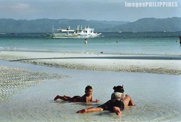"""""""Father and Son at the Beach"""",  Place Taken: Boracay Island, Aklan take on  Date Taken: 2003"""