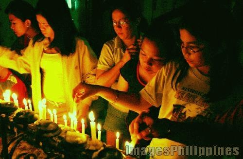 """""""Lighting Candles"""",  Place Taken: San Juan, Batangas take on  Date Taken: 2004"""