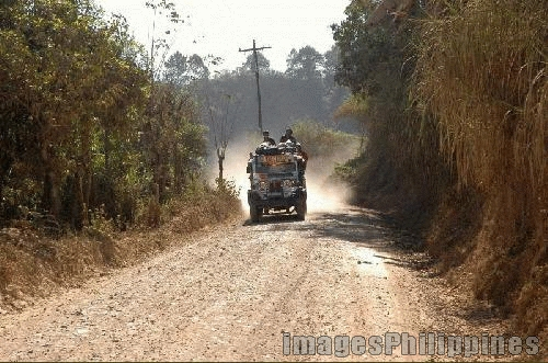 """""""Day in Day out jeep in the old dusty road"""",  Place Taken: Benguet take on  Date Taken: 2005"""