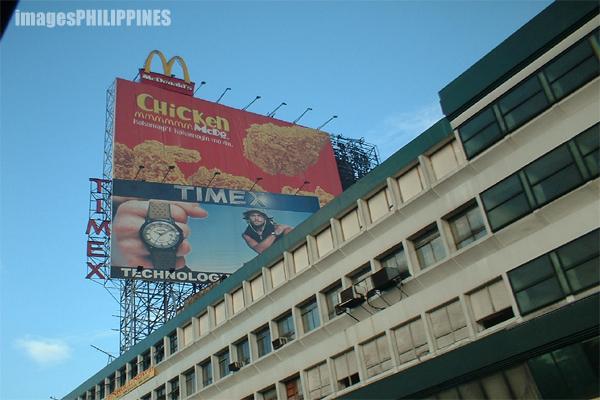 """""""Billboards along EDSA"""",  Place Taken: Mandaluyong City take on  Date Taken: 2003"""