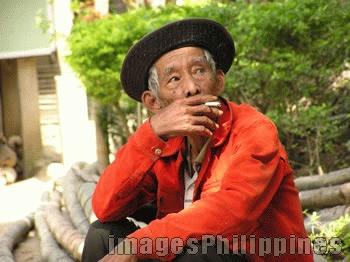 """""""Smoking lolo"""",  Place Taken: Anilao, Batangas take on  Date Taken: 2005"""