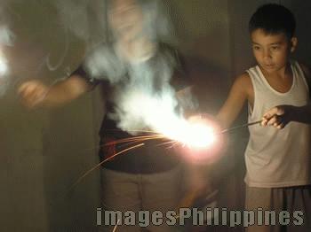"""""""Play with Fire"""",  Place Taken: Metro Manila take on  Date Taken: 2004"""
