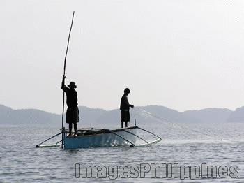 """""""100 Islands Fishermen"""",  Place Taken: 100 Islands, Lucap, Pangasinan take on  Date Taken: 2004"""