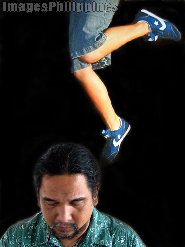 """""""Kicking Mr. Clean"""",  Place Taken: Metro Manila take on  Date Taken: 2004"""