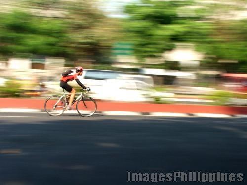 """Cyclist"",  Place Taken: Metro Manila take on  Date Taken: 2006"