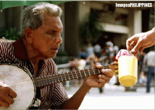 """Guitarman"",  Place Taken: San Pedro, Cathedral, Davao City take on  Date Taken: 2004"