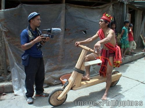 """""""Interviewing a Scooter Rider"""",  Place Taken: Ifugao take on  Date Taken: 2008"""