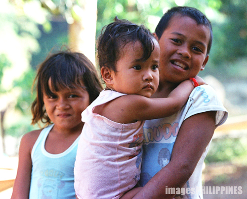 """Lumad three children"",  Place Taken: Malaybalay, Bukidnon take on  Date Taken: 2004"