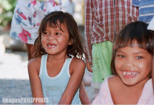 """""""Lumad Youngster at Play"""",  Place Taken: Malaybalay, Bukidnon take on  Date Taken: 2004"""