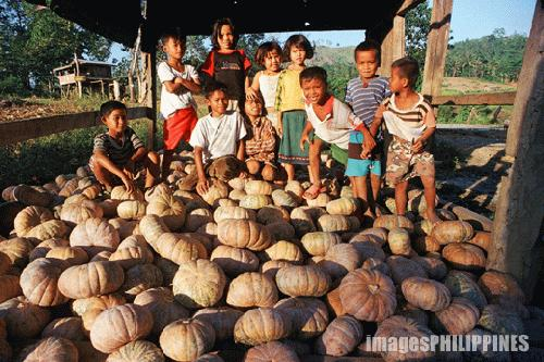 """Lumad Youngsters over files of squash"", 