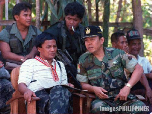 """""""Balweg with a Military Official"""" ,  Place Taken:  Abra take on  Date Taken: 1987"""