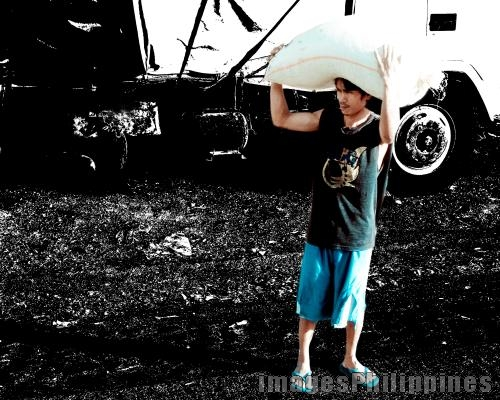 Carry that Rice,  Place Taken: Aklan take on  Date Taken: 2010