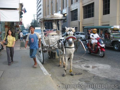 Kalesa ride in tourist belt,  Place Taken: Metro Manila take on  Date Taken: 2005