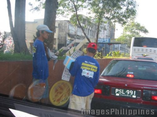 Street Vendors,  Place Taken: Metro Manila take on  Date Taken: 2005