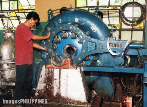 """Mini Hydro Operator Inspects Turbine"" , 