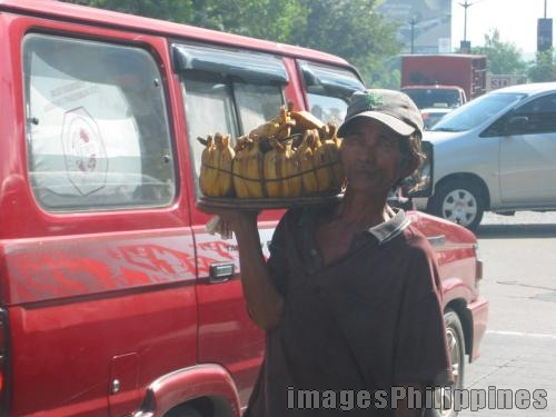 Street Vendor,  Place Taken: Metro Manila take on  Date Taken: 2006