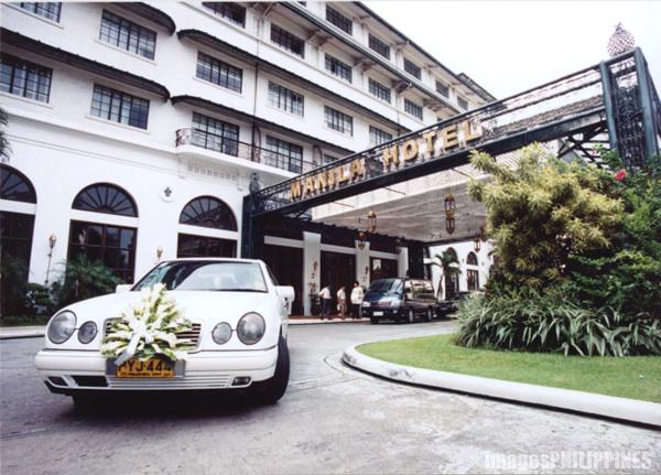 """""""Bridal Car leaving Manila Hotel"""",  Place Taken: Metro Manila take on  Date Taken: 2001"""