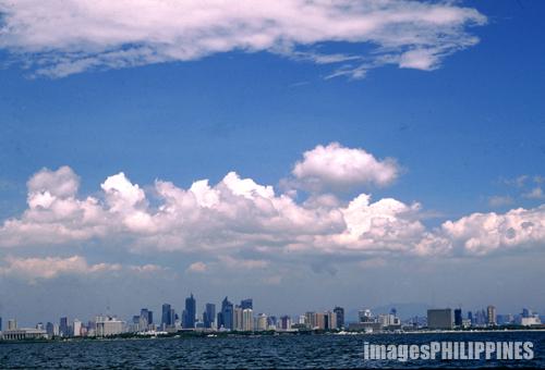 """""""Manila Skyline at the Bay"""",  Place Taken: Metro Manila take on  Date Taken: 2002"""