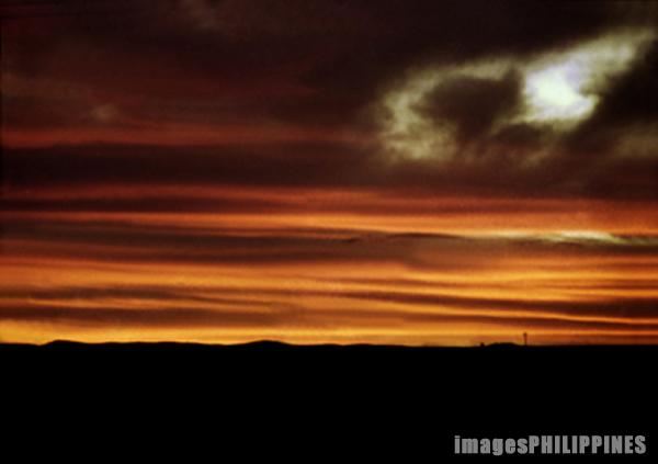 """Bataan glow before sunrise at Bagac town from ,  Date Taken: 1991 take on  Photographer/Artist: Nestor Santiago"