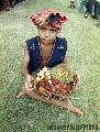 """T'boli boy with Fruits""