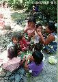 """Lumad Children enjoying lunch"",