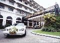 """Bridal Car leaving Manila Hotel"",